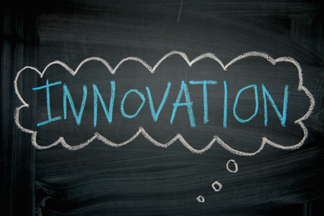 the word Innovation in a bubble on a chalkboard
