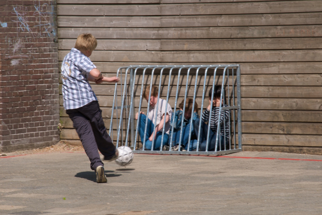 bully on the playground, kids playing soccer