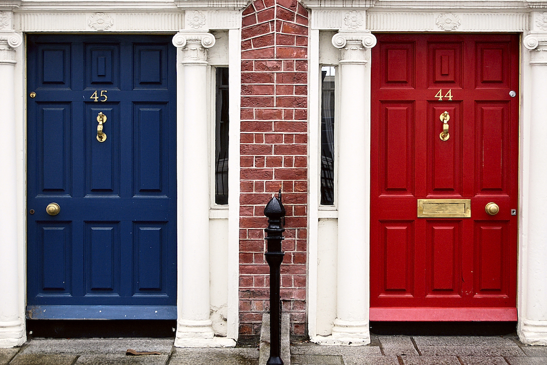 Row home with blue door and one with red door