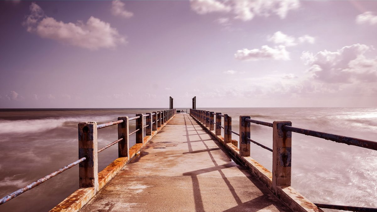 pier over water with clear sky