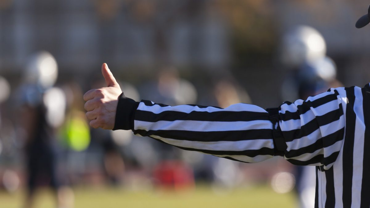 referee with thumbs up