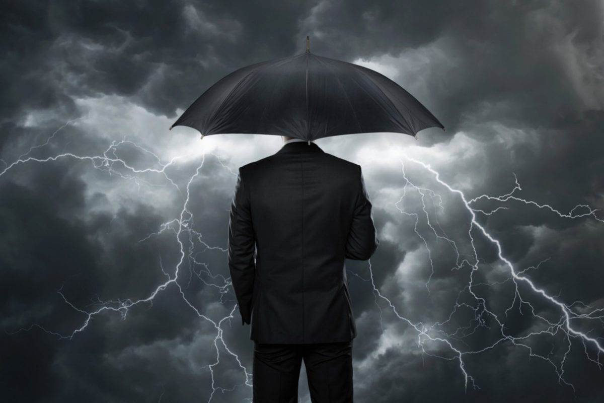man with black umbrella in strom
