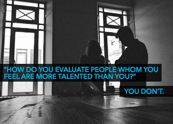 """Two business people at a table with the words: """"how do you evaluate people whom you feel are more talented than you? You don't."""""""