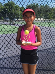 Daughter with tennis trophy.