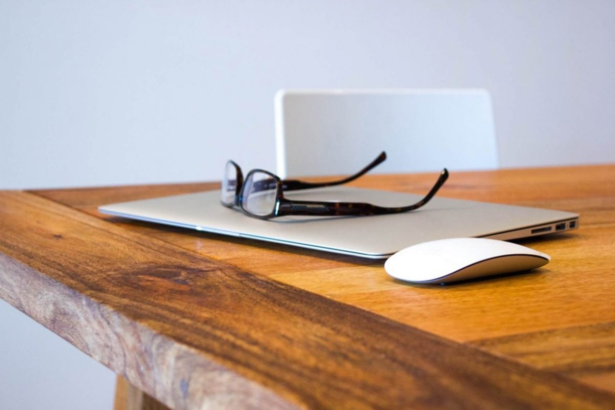 glasses on a computer on a table